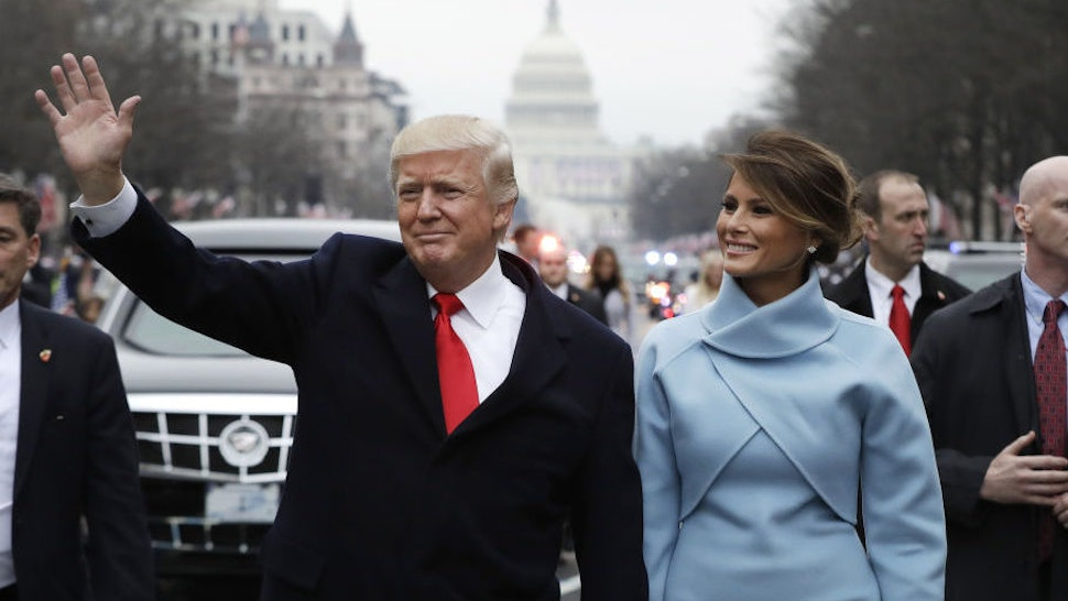 U.S. President Donald Trump waves while walking with U.S. First Lady Melania Trump during a parade following the 58th presidential inauguration in Washington, D.C., U.S., on Friday, Jan. 20, 2017. Monday, January 20, 2020, marks the third anniversary of U.S. President Donald Trump's inauguration. Our editors select the best archive images looking back over Trump's term in office. Photographer: Evan Vucci/Pool via Bloomberg