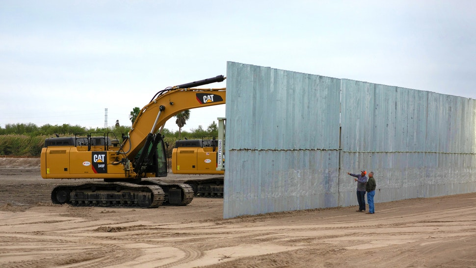 MISSION, TEXAS - DECEMBER 11: A construction crew works on a section of privately built border wall on December 11, 2019 near Mission, Texas. The hardline immigration group We Build The Wall is funding the construction of the wall on private land along a stretch of the Rio Grande, which forms the border with Mexico. The group, led by former Trump strategist Stephen Bannon claims to have raised tens of millions of dollars in a GoFundMe drive to build sections of wall along several stretches of the southwest border with Mexico.