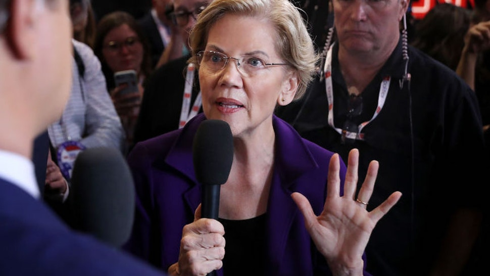 WESTERVILLE, OHIO - OCTOBER 15: Presidential candidate Sen. Elizabeth Warren (D-MA) talks with MSNBC host Chris Hays in the Spin Room following the fourth Democratic presidential debate in the Clements Recreation Center at Otterbein University October 15, 2019 in Westerville, Ohio. A record 12 presidential hopefuls are participating in the debate hosted by CNN and The New York Times.