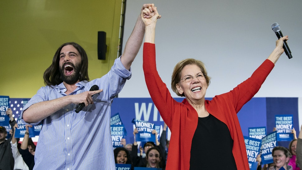 """Senator Elizabeth Warren, a Democrat from Massachusetts and 2020 presidential candidate, right, arrives with Jonathan Van Ness, a celebrity hairdresser, during a campaign event in Cedar Rapids, Iowa, U.S., on Sunday, Jan. 26, 2020. The Des Moines Register endorsed progressive favorite Warren a little more than a week before the Iowa caucuses on Feb. 3, saying the Massachusetts lawmaker would """"push an unequal America in the right direction."""""""