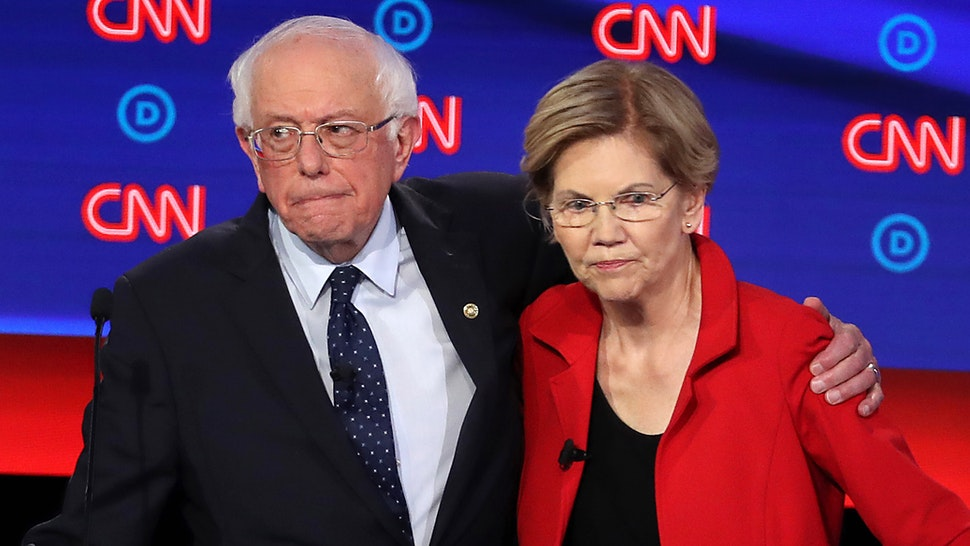 DETROIT, MICHIGAN - JULY 30: Democratic presidential candidate Sen. Bernie Sanders (I-VT) (L) and Sen. Elizabeth Warren (D-MA) embrace after the Democratic Presidential Debate at the Fox Theatre July 30, 2019 in Detroit, Michigan. 20 Democratic presidential candidates were split into two groups of 10 to take part in the debate sponsored by CNN held over two nights at Detroit's Fox Theatre.