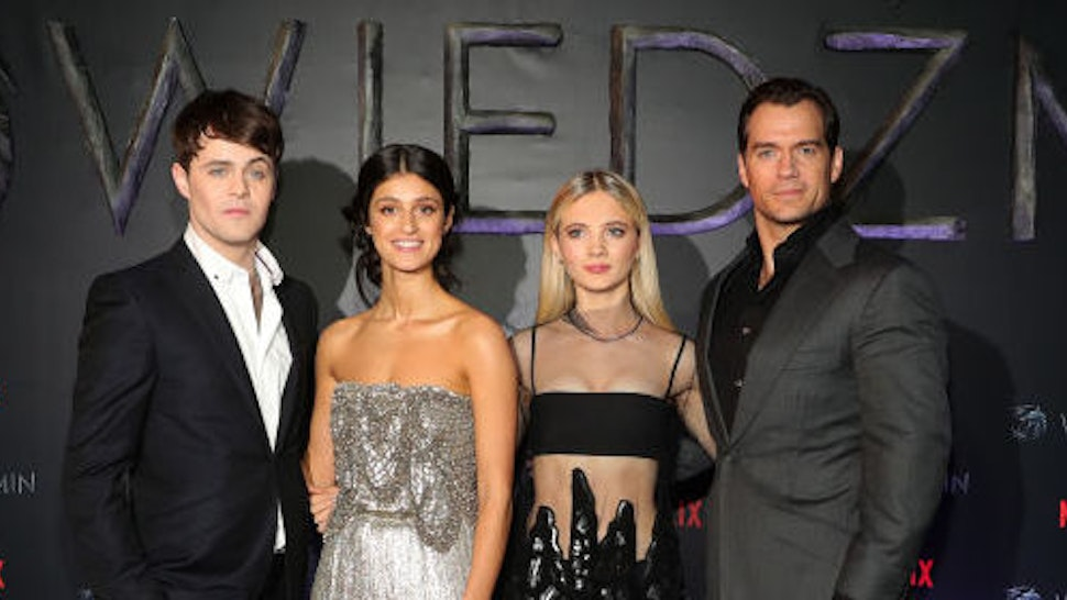 """Joey Batey, Anya Chalotra, Freya Allan and Henry Cavill attend the premiere of the Netflix series """"The Witcher"""" (Wiedzmin) on December 18, 2019 in Warsaw, Poland. (Photo by Andreas Rentz/Getty Images for Netflix)"""