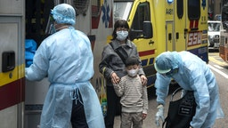 HONG KONG, CHINA - 2020/01/23: Health care members make first aid to people as they cover their faces with sanitary masks after the first cases of coronavirus have been confirmed in Hong Kong in Hong Kong, China has implemented a public transportation and airport lock down into different cities to slow down the spread of the Wuhan coronavirus.