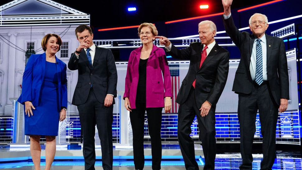 2020 presidential candidates Senator Amy Klobuchar, a Democrat from Minnesota, from left, Pete Buttigieg, mayor of South Bend, Senator Elizabeth Warren, a Democrat from Massachusetts, Former U.S. Vice President Joe Biden, and Senator Bernie Sanders, an independent from Vermont, stand on stage for the Democratic presidential debate in Atlanta, Georgia, U.S., on Wednesday, Nov. 20, 2019. The Democratic presidential races new pecking order will be on full display Wednesday night, with Pete Buttigieg taking the debate stage as the emerging front-runner in Iowa and top 2020 rivals Joe Biden and Senator Elizabeth Warren trying to knock him off that perch.