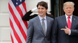 Canadian Prime Minister Justin Trudeau (L) and U.S. President Donald Trump pose for photographs at the White House October 11, 2017 in Washington, DC. The United States, Canada and Mexico are currently engaged in renegotiating the 25-year-old North American Free Trade Agreement