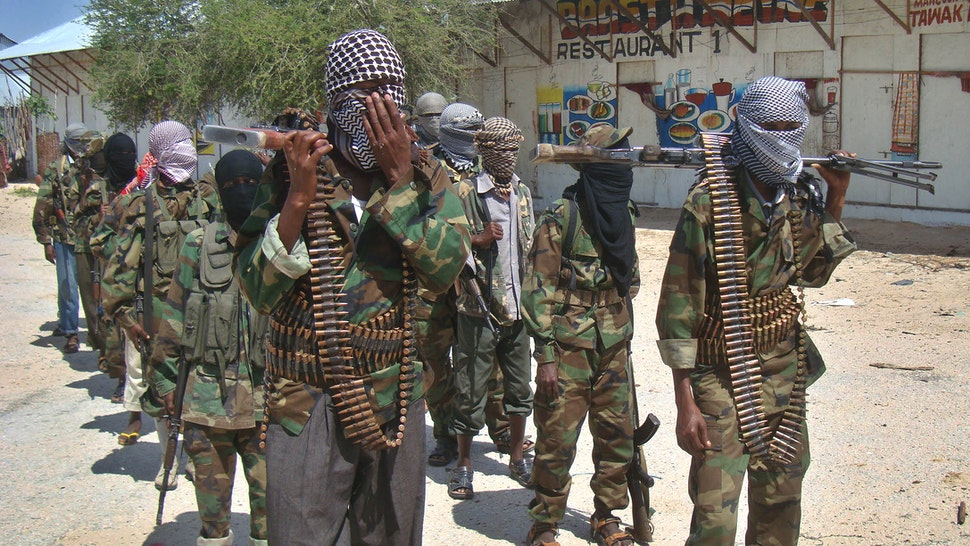 "Al-Qaeda linked al-shabab recruits walk down a street on March 5, 2012 in the Deniile district of Somalian capital, Mogadishu, following their graduation. The walls of the former Shebab base in Baidoa, Somalia, are littered with rudimentary drawings of machine guns and tanks, a note reading ""Fear God, don't write on these walls"" and a sketch of an Al-Qaeda flag, homage to the rebel group's international allies. The crumbling building is now occupied by Ethiopian troops who nearly two weeks ago forced Shebab rebels out of Baidoa, their former Shebab stronghold and Somalia's third-largest city."