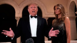 US President Donald Trump and First Lady Melania Trump speak to the press outside the grand ballroom as they arrive for a New Year's celebration at Mar-a-Lago in Palm Beach, Florida, on December 31, 2019. (Photo by JIM WATSON / AFP) (Photo by