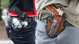 Art and Diana Ramirez of Austin with their pistols in custom-made holsters during and open carry rally at the Texas State Capitol on January 1, 2016 in Austin, Texas.