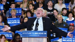 Democratic presidential candidate Sen. Bernie Sanders (D-VT) jokes around as he speaks during a campaign rally at Bonanza High School on February 14, 2016 in Las Vegas, Nevada.