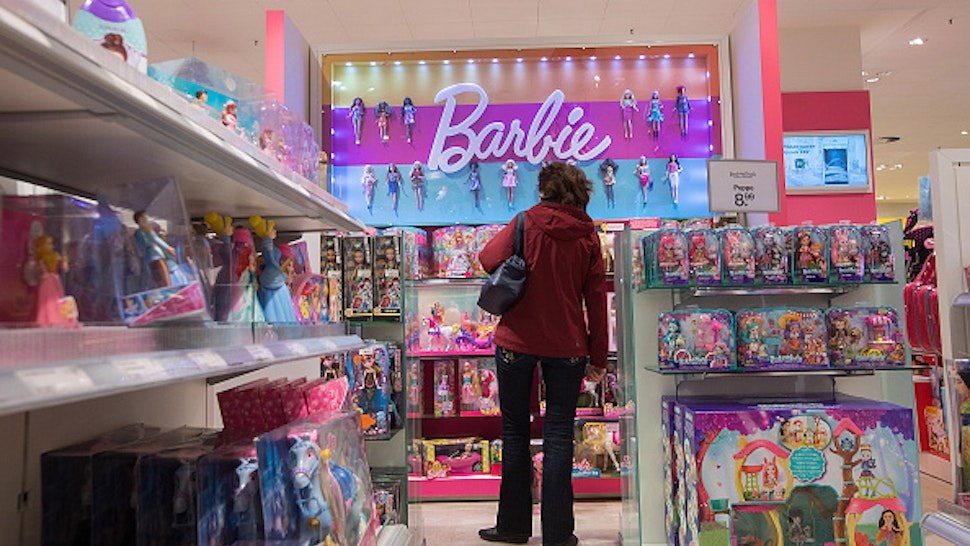 A customer stands beside a Barbie toy doll display inside a Galeria Kaufhof department store, operated by Hudson's Bay Co., in Berlin, Germany, on Wednesday, Dec. 6, 2017. Austrian property developer Rene Benko is taking a second run at consolidating Germany's dusty department stores, making an unsolicited bid for the Kaufhof chain now owned by Toronto-based Hudson's Bay.