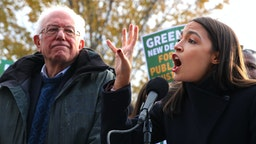 WASHINGTON, DC - NOVEMBER 14: Democratic presidential candidate Sen. Bernie Sanders (I-VT) (L) and Rep. Alexandria Ocasio-Cortez (D-NY) hold a news conference to introduce legislation to transform public housing as part of their Green New Deal proposal outside the U.S. Capitol November 14, 2019 in Washington, DC. The liberal legislators invited affordable housing advocates and climate change activists to join them for the announcement.