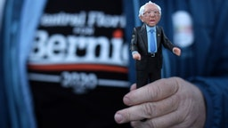 A supporter holds a Bernie action figure outside a campaign event of Democratic presidential candidate Sen. Bernie Sanders (I-VT) at Ingersoll Tap February 2, 2020 in Des Moines, Iowa. The Iowa caucuses will be held on February 3. (Photo by Alex Wong/Getty Images)