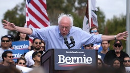 Democratic presidential hopeful Vermont Senator Bernie Sanders gestures as he speaks during a rally at Valley High School in Santa Ana, California, February 21, 2020.