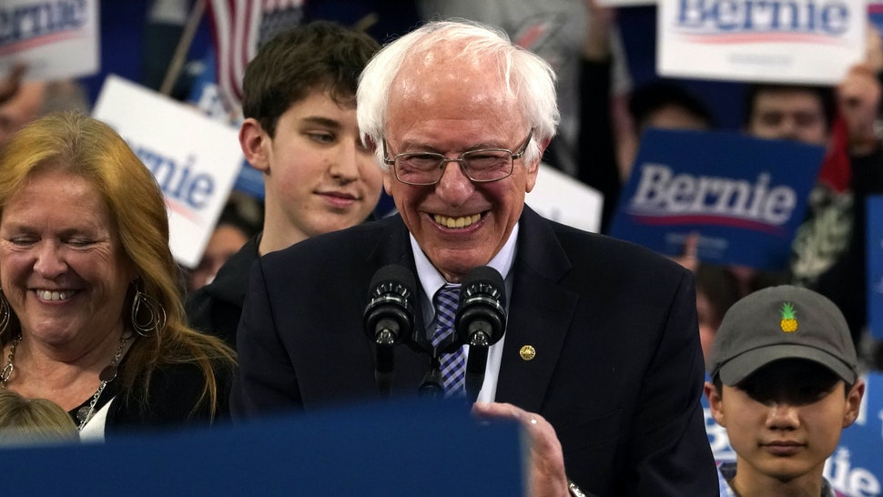 Democratic presidential hopeful Vermont Senator Bernie Sanders arrives to speak at a Primary Night event at the SNHU Field House in Manchester, New Hampshire on February 11, 2020. - Bernie Sanders won New Hampshire's crucial Democratic primary, beating moderate rivals Pete Buttigieg and Amy Klobuchar in the race to challenge President Donald Trump for the White House, US networks projected.