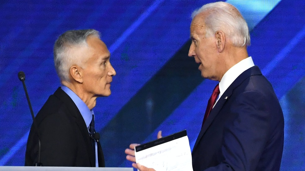 US-Mexican journalist Jorge Ramos (L) speaks with Former Vice President Joe Biden during the third Democratic primary debate of the 2020 presidential campaign season hosted by ABC News in partnership with Univision at Texas Southern University in Houston, Texas on September 12, 2019.