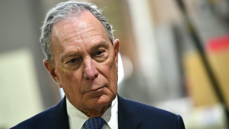 US Democratic Presidential candidate, Mike Bloomberg, looks on while visiting 'Building Momentum', a veteran owned business in Alexandria, Virginia on February 7, 2020.
