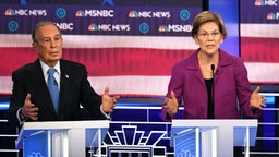 Democratic presidential hopefuls Massachusetts Senator Elizabeth Warren (R) and former New York Mayor Mike Bloomberg gesture during the ninth Democratic primary debate of the 2020 presidential campaign season co-hosted by NBC News, MSNBC, Noticias Telemundo and The Nevada Independent at the Paris Theater in Las Vegas, Nevada, on February 19, 2020.