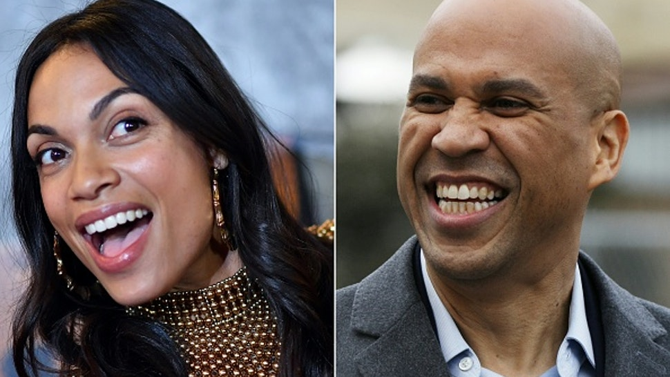 """(COMBO) This combination of pictures created on March 14, 2019 shows US actress Rosario Dawson attending the Netflix Original Series Marvel's Luke Cage Season 2 New York City Premiere on June 21, 2018 in New York City, and US Senator Cory Booker (D-NJ) arrives for a press conference announcing his run for US president in 2020, on February 1, 2019, outside his home in Newark, New Jersey. - Senator Cory Booker, one of more than a dozen Democrats seeking the party's tip to run for president in 2020, is in a relationship with star Latina actress Rosario Dawson, Dawson confirmed on March 14, 2019. While Booker has long been intensely private about his relationships, Dawson confirmed it on camera to TMZ as she walked through Washington's national Airport.Were the rumors true? asked the TMZ reporter.""""Yes. Very much so,"""" Dawson replied, adding: """"So far so wonderful, he's a wonderful human being. It's good to spend some time together when we can."""""""