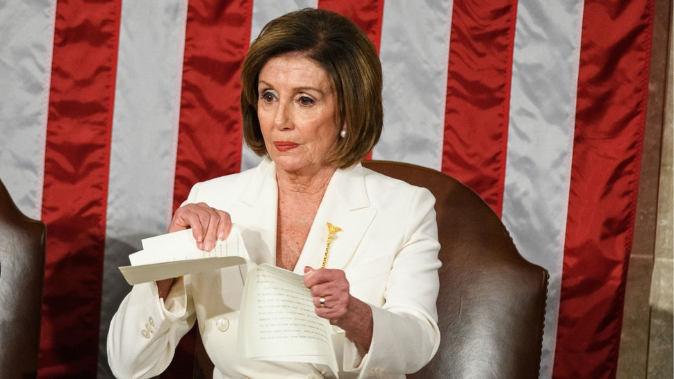 Speaker of the US House of Representatives Nancy Pelosi rips a copy of US President Donald Trumps speech after he delivers the State of the Union address at the US Capitol in Washington, DC, on February 4, 2020.