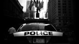 A New York City police car blocks traffic from entering Vanderbilt street in front of Grand Central station August 4, 2004 in New York City.