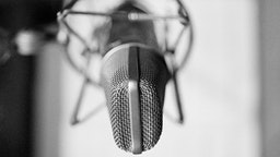 General view of a condenser microphone in a shock mount in a recording studio, circa 1980.