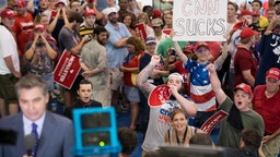 People shout behind CNN reporter Jim Acosta before a campaign rally for South Carolina Governor Henry McMaster featuring President Donald Trump at Airport High School June 25, 2018 in West Columbia, South Carolina. (Photo by Sean Rayford/Getty Images)