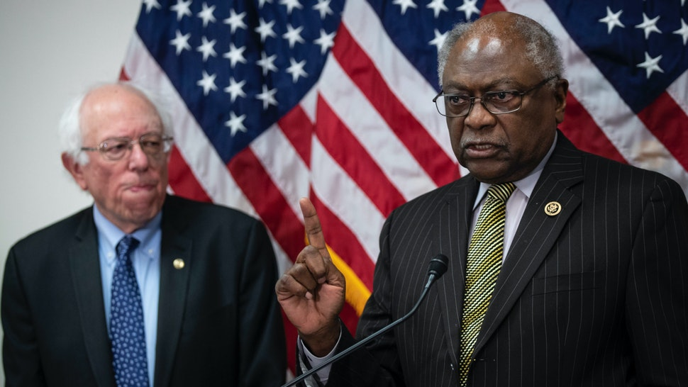 Sen. Bernie Sanders (I-VT) looks on as Rep. James Clyburn (D-SC) speaks during a press conference to announce legislation to extend and expand funding for community health centers and the National Health Service Corps, at the U.S. Capitol on March 28, 2019 in Washington, DC.