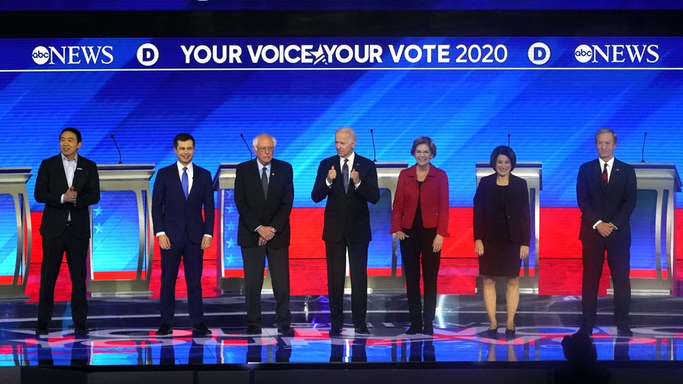 (From L) Democratic presidential hopefuls entrepreneur Andrew Yang, former Mayor of South Bend, Indiana, Pete Buttigieg, Vermont Senator Bernie Sanders, former Vice President Joe Biden, Massachusetts Senator Elizabeth Warren, Minnesota Senator Amy Klobuchar and Billionaire activist Tom Steyer arrive onstage for the eighth Democratic primary debate of the 2020 presidential campaign season co-hosted by ABC News, WMUR-TV and Apple News at St. Anselm College in Manchester, New Hampshire, on February 7, 2020.