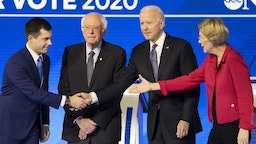 Pete Buttigieg, former mayor of South Bend and 2020 presidential candidate, left, shakes hands with Former Vice President Joe Biden, as Senator Bernie Sanders, an Independent from Vermont, second left, and Senator Elizabeth Warren, a Democrat from Massachusetts, right, stand on stage ahead of the Democratic presidential debate at Saint Anselm College in Manchester, New Hampshire, U.S., on Friday, Feb. 7, 2020. The New Hampshire debates often mark a turning point in a presidential campaign, as the field of candidates is winnowed and voters begin to pay closer attention. Photographer: Adam Glanzman/Bloomberg