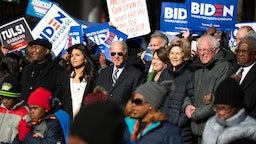 Democratic presidential candidates, Rep. Tulsi Gabbard (D-HI), left, former Vice President Joe Biden, Sen. Amy Klobuchar (D-MN), Sen. Elizabeth Warren (D-MA), and Sen. Bernie Sanders (I-VT), right, march on Main St. to the King Day at the Dome event with Democratic candidate for U.S. Senate Jaime Harrison, far left, on January 20, 2020 in Columbia, South Carolina. The event, first held in 2000 in opposition to the display of the Confederate battle flag at the statehouse, attracted more than a handful of Democratic presidential candidates to the early primary state. (Photo by Sean Rayford/Getty Images)