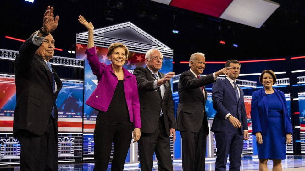 2020 presidential candidates Mike Bloomberg, founder of Bloomberg LP, from left, Senator Elizabeth Warren, a Democrat from Massachusetts, Senator Bernie Sanders, an Independent from Vermont, former Vice President Joe Biden, Pete Buttigieg, former mayor of South Bend, and Senator Amy Klobuchar, a Democrat from Minnesota, stand on stage ahead of the Democratic presidential candidate debate in Las Vegas, Nevada, U.S., on Wednesday, Feb. 19, 2020. Beneath all of the sparring between candidates leading up to the debate is a broader strategic question that Democrats must address: Whether the best way to beat President Donald Trump in November is by reassuring moderates with kitchen-table proposals or by bolstering turnout with aggressive ideas that create a clear contrast. Photographer: Joe Buglewicz/Bloomberg