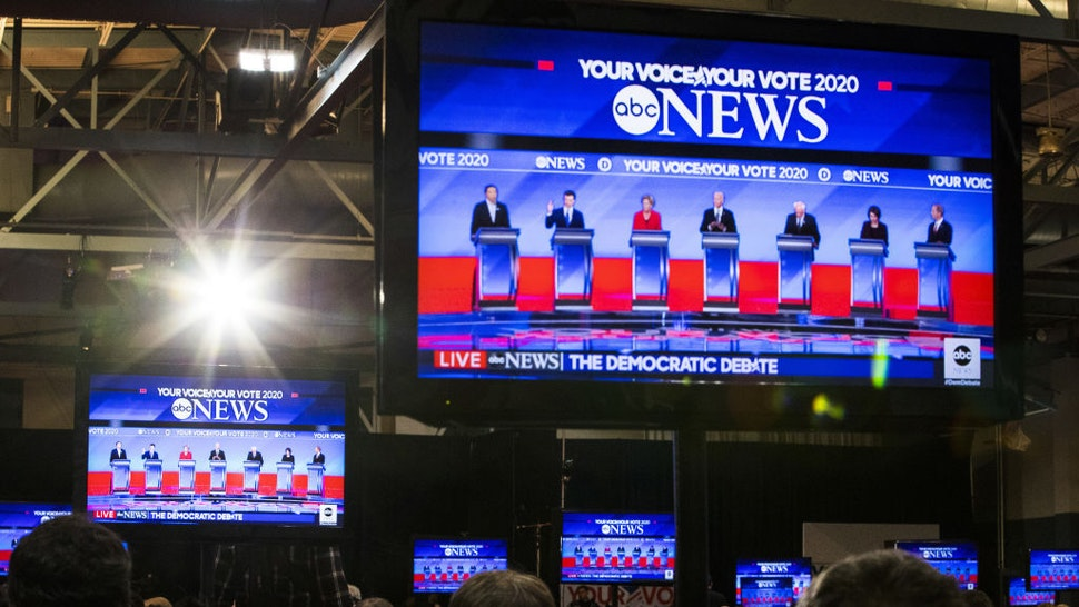 2020 Democratic presidential candidates are seen on television screens in the spin room during the Democratic presidential debate at Saint Anselm College in Manchester, New Hampshire, U.S., on Friday, Feb. 7, 2020. The New Hampshire debates often mark a turning point in a presidential campaign, as the field of candidates is winnowed and voters begin to pay closer attention. Photographer: Adam Glanzman/Bloomberg