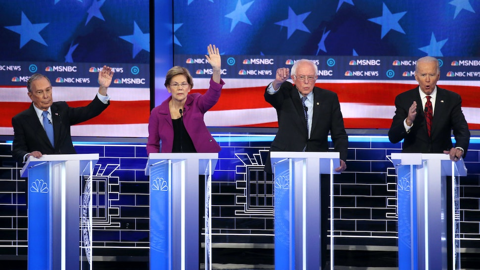 LAS VEGAS, NEVADA - FEBRUARY 19: Democratic presidential candidates (L-R) former New York City mayor Mike Bloomberg, Sen. Elizabeth Warren (D-MA) and Sen. Bernie Sanders (I-VT) raise their hands as former Vice President Joe Biden (R) speaks during the Democratic presidential primary debate at Paris Las Vegas on February 19, 2020 in Las Vegas, Nevada. Six candidates qualified for the third Democratic presidential primary debate of 2020, which comes just days before the Nevada caucuses on February 22.