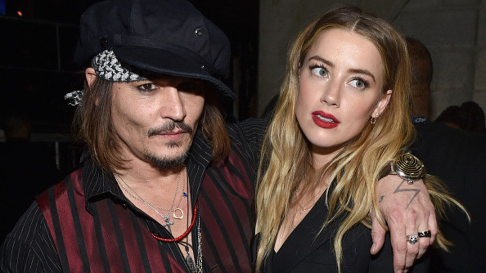 LOS ANGELES, CA - FEBRUARY 15: Actor/musician Johnny Depp (L) and actress Amber Heard attend The 58th GRAMMY Awards at Staples Center on February 15, 2016 in Los Angeles, California.