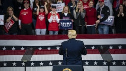 U.S. President Donald Trump speaks during a rally in Des Moines, Iowa, U.S., on Thursday, Jan. 30, 2020. Trump and Democratic presidential hopeful Michael Bloomberg on Thursday unveiled dueling multimillion-dollar campaign ads that are scheduled to air during the Super Bowl on Sunday. Photographer: Al Drago/Bloomberg