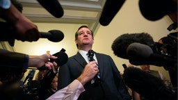 Sen. Ted Cruz (R-TX) is speaks to the media as he returns to his office at the U.S. Capitol, May 10, 2016, in Washington, DC.