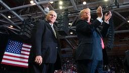 US President Donald Trump alongside radio talk show host Rush Limbaugh arrive at a Make America Great Again rally in Cape Girardeau, Missouri on November 5, 2018.