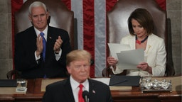 President Donald Trump, with Speaker Nancy Pelosi and Vice President Mike Pence looking on, delivers the State of the Union address in the chamber of the U.S. House of Representatives at the U.S. Capitol Building on February 5, 2019 in Washington, DC.