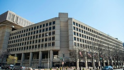 The J. Edgar Hoover Building of the Federal Bureau of Investigation (FBI) is seen on April 03, 2019 in Washington, DC. - The FBI is the domestic intelligence and security service of the United States, and its principal federal law enforcement agency. Operating under the jurisdiction of the United States Department of Justice, the FBI is also a member of the U.S. Intelligence Community and reports to both the Attorney General and the Director of National Intelligence. (Photo by Eric BARADAT / AFP)