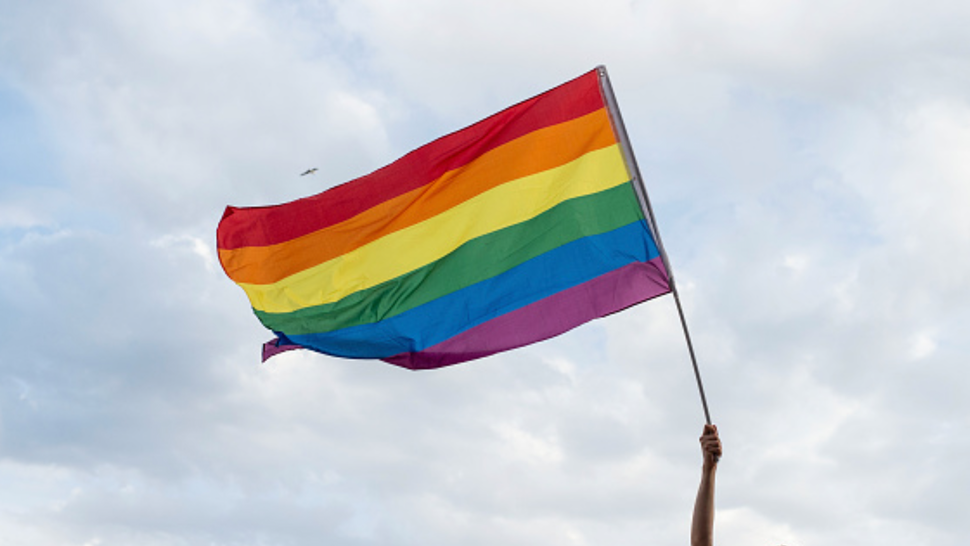 NAPLES, ITALY - JUNE 22: An activist of the LGBT movement with a flag during the 12th Mediterranean Pride of Naples on June 22, 2019 in Naples, Italy. The Mediterranean Pride of Naples is one of the many events of Pride Month scheduled in Italy and around the world, inspired by the Stonewall riots of 1969, when protests and clashes between police and homosexual groups took place in New York, symbolically the moment of birth of the modern gay liberation movement throughout the world.