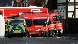 Vehicles of the police and the fire brigades stand at the site where a man who drove into a carnival procession, on February 25, 2020 in Volkmarsen near Kassel, central Germany. - A car that rammed into a carnival procession in Volkmarsen on Rose Monday, February 24, 2020, injured 52 people, including 18 children, police said, adding that the perpetrator's motive remains unclear.