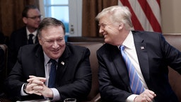 U.S. President Donald Trump, right, and Mike Pompeo, U.S. secretary of state, laugh during a meeting at the White House in Washington, D.C., U.S., on Wednesday, July 18, 2018.