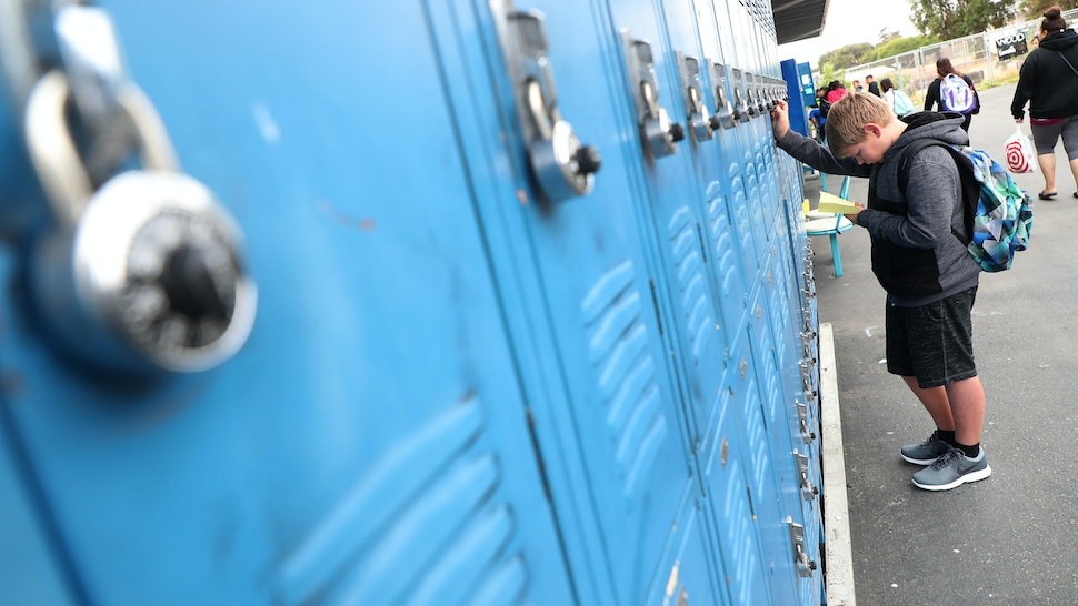 ALAMEDA, CA - AUGUST 19: Sixth grade student Matthew Severson works to open his locker on the first day of class at Will C. Wood Middle School on Monday, August 20, 2018, in Alameda, California. (Photo by Aric Crabb/Digital First Media/Bay Area News via Getty Images)