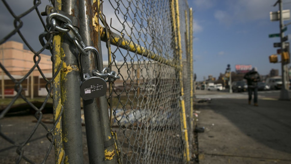 A padlock is seen on a fence surrounding an abandoned lot, where East Harlem Media Entertainment and Cultural Center is planned to be built, in the East Harlem neighborhood of New York, U.S., on Wednesday, Dec. 12, 2018.