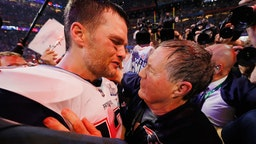 Tom Brady #12 of the New England Patriots talks to head coach Bill Belichick of the New England Patriots after the Patriots defeat the Rams 13-3 during Super Bowl LIII at Mercedes-Benz Stadium on February 3, 2019 in Atlanta, Georgia.