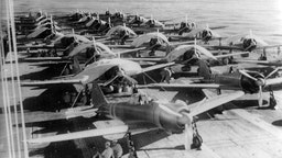 Aircraft are prepared for a morning sortie on the Imperial Japanese Navy aircraft carrier Zuikaku, east of the Solomon Islands, on May 5, 1942.
