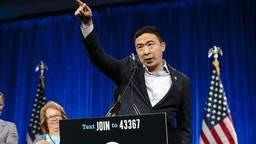 Andrew Yang, founder of Venture for America and 2020 Democratic presidential candidate, gestures while speaking during the Democratic National Committee (DNC) Summer Meeting in San Francisco, California, U.S., on Friday, Aug. 23, 2019.