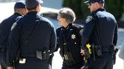 Oakland police Chief Anne Kirkpatrick greets officers as she arrives to the Ascension Greek Orthodox Cathedral of Oakland to attend a department promotion ceremony in Oakland, Calif., on Friday, July 14, 2017.