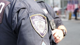 The New York City Police Department (NYPD) logo can be seen on a uniform during the 18th anniversary of the September 11, 2001 terrorist attacks near Ground Zero.