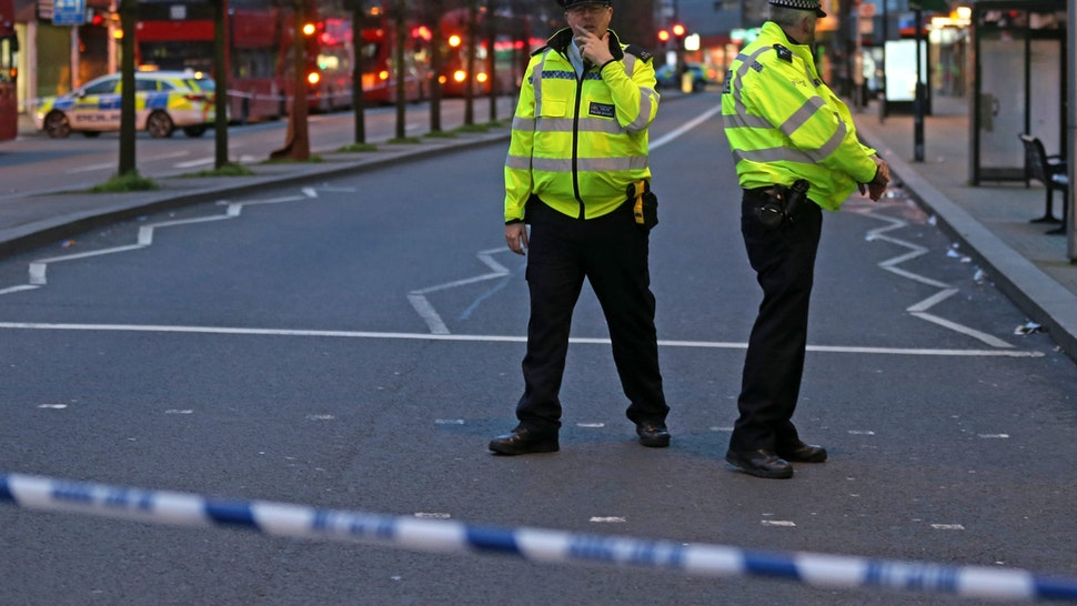 "Police officers guard a cordon, set up on Streatham High Road, at the junction of Woodbourne Road, in south London on February 2, 2020, after a man is shot dead by police following reports of people being stabbed in the street. - British police on Sunday said they had shot a man in south London, after at least two people were stabbed in a suspected ""terrorist-related"" incident. (Photo by ISABEL INFANTES / AFP) (Photo by ISABEL INFANTES/AFP via Getty Images)"